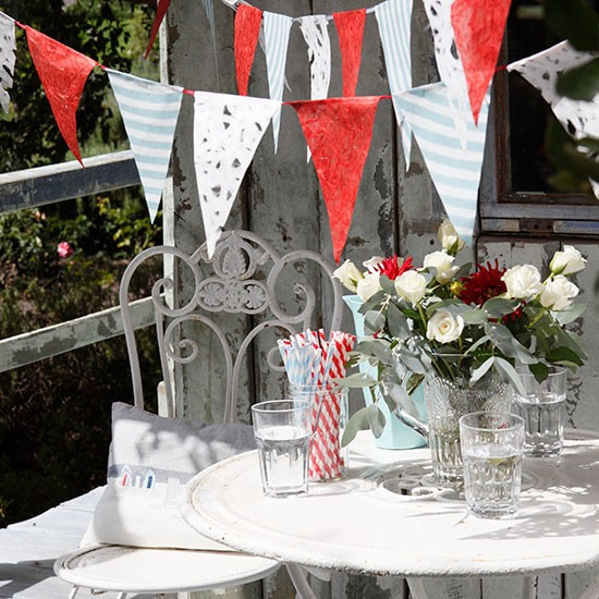 Summer garden with bright bunting and retro straws