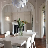 Neutral modern dining-living room with period features