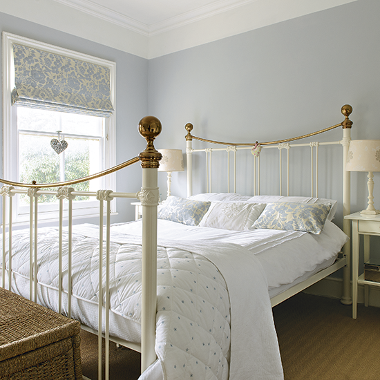 Pale blue bedroom with traditional white bed frame for Bedroom designs uk