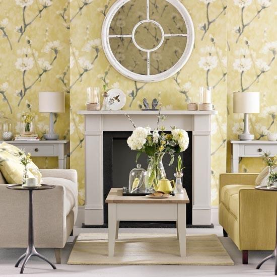 soft floral living room with armchairs fireplace and mirror