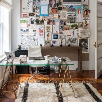 White home office with photograph feature wall
