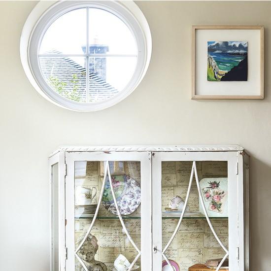 coastal living room with porthole window coastal living. Black Bedroom Furniture Sets. Home Design Ideas