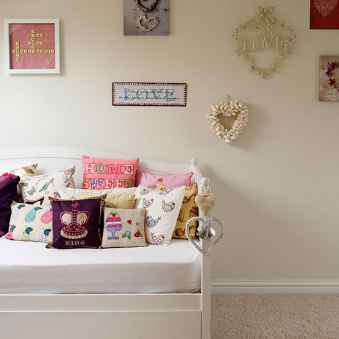 Neutral children's room with wall art