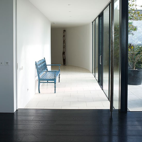 Hallway With Black Wood Flooring And White Tiles Black