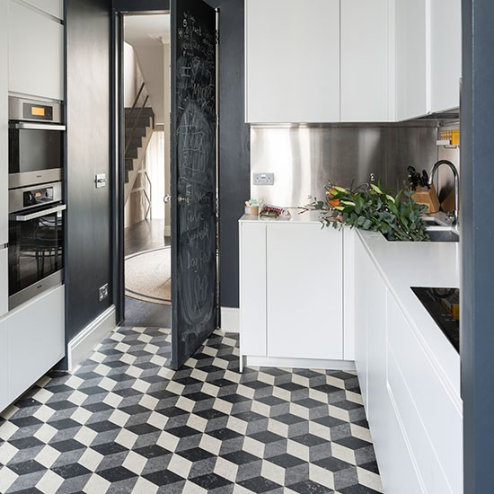 Kitchen With Black And White Geometric Flooring