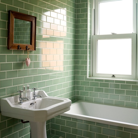 Bathroom with green metro tiles decorating with tropical colours