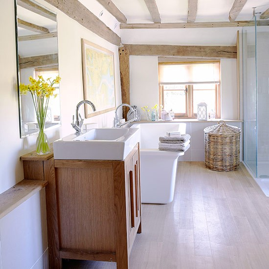 White and pine bathroom with exposed beams