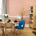 Dining room with geometric print wallpaper and mid-century bookcase