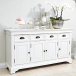 Traditional white dining room sideboard with floral display
