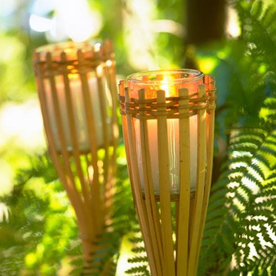 garden with bamboo torches garden lighting ideas