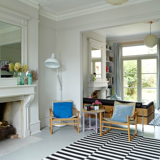 White Living Room With Black Striped Rug Decorating With