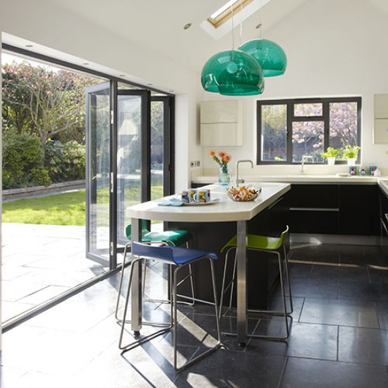 Contemporary kitchen with folding sliding doors modern for Kitchen extensions ideas designs