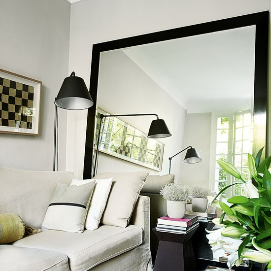 living room with oversized mirror rented property decorating ideas