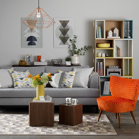 Grey living room with orange chair scandinavian design for Grey and orange living room ideas
