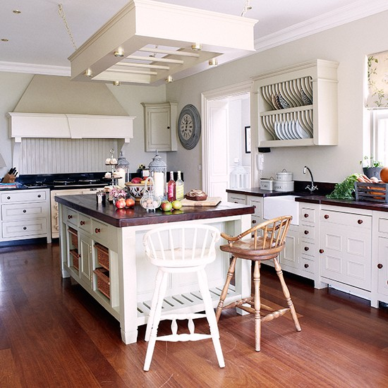 White kitchen with mellow wood floor kitchen flooring for Country kitchen flooring