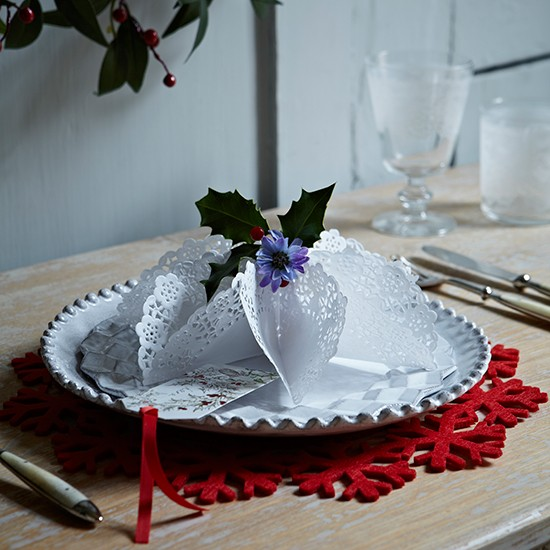 Folded doily decoration on white plate with red felt placemat  country homes and interiors  housetohome.co.uk