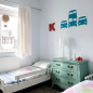Boys' bedroom with wall stickers and turquoise chest of drawers