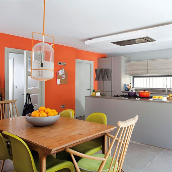 Orange and grey kitchen decorating with bright colours for Colour scheme for kitchen walls