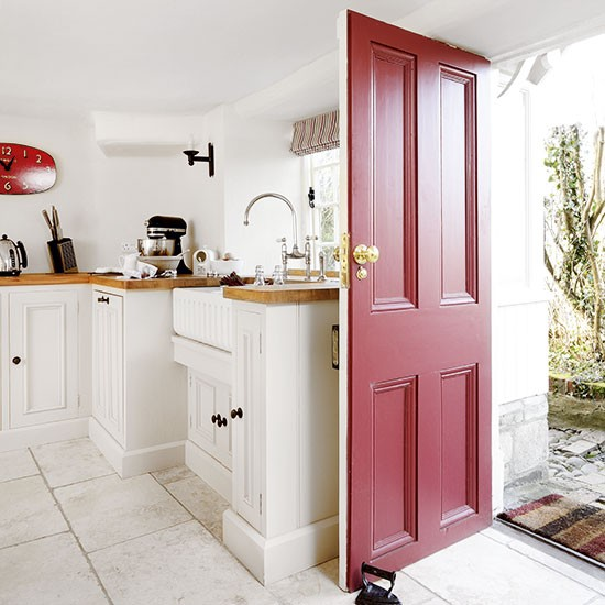 White Country Kitchen With Red Door