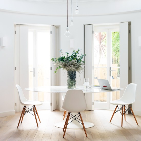Dining room with contemporary white furniture take a for Modern white dining room chairs