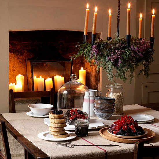 Rustic Christmas dining room with fireplace candles  : Country Christmas table setting with candle chandelier Country Homes and Interiors Housetohomecouk from www.housetohome.co.uk size 550 x 550 jpeg 93kB
