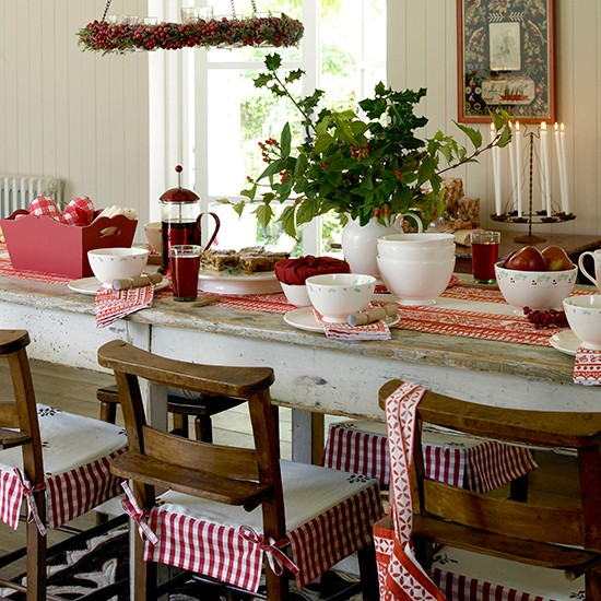 classic christmas dining room with natural foliage