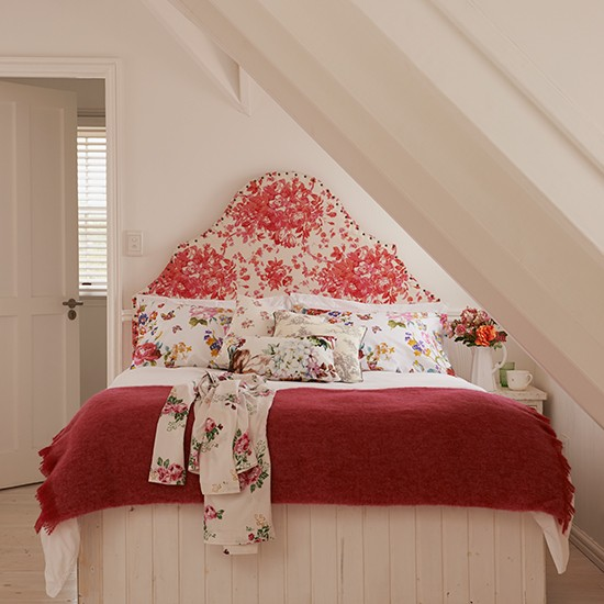 Bedroom With Sloping Ceiling Shaped Headboard In Floral