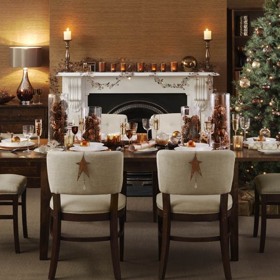 Glam copper Christmas dining room with pinecone centrepiece | Traditional Christmas decorating ideas | PHOTO GALLERY | Ideal Home | Housetohome.co.uk