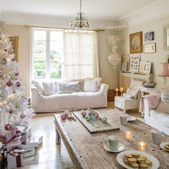 Country Christmas living room with white faux Christmas tree, distressed coffee table and white sofas