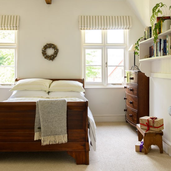 neutral bedroom with mahogany sleigh bed 19th century cottage in
