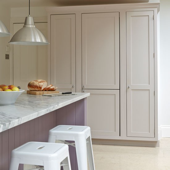 White And Lavender Kitchen With Floor-to-ceiling Cupboards