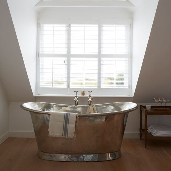 White bathroom with metallic bateau bath | West Sussex country house | House tour | PHOTO GALLERY | Country Homes and Interiors | Housetohome.co.uk