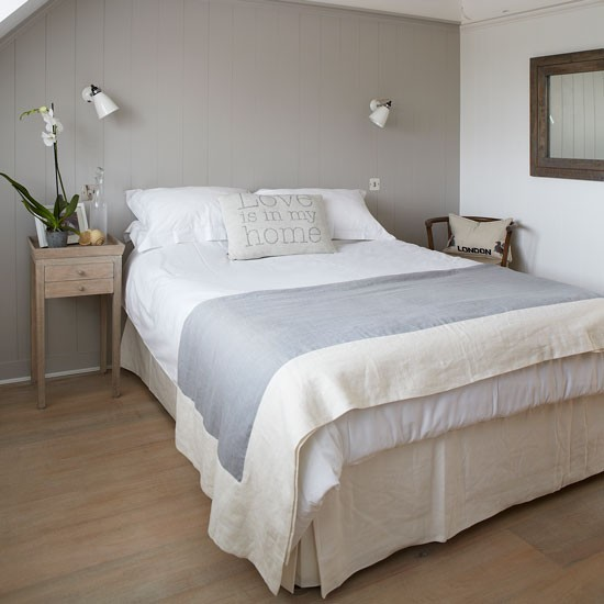 Pale grey guest bedroom with statement cushion | West Sussex country house | House tour | PHOTO GALLERY | Country Homes and Interiors | Housetohome.co.uk