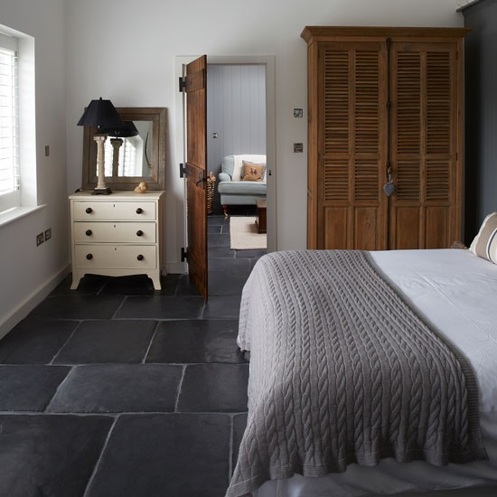 Neutral guest bedroom with grey slate floor | West Sussex country house | House tour | PHOTO GALLERY | Country Homes and Interiors | Housetohome.co.uk