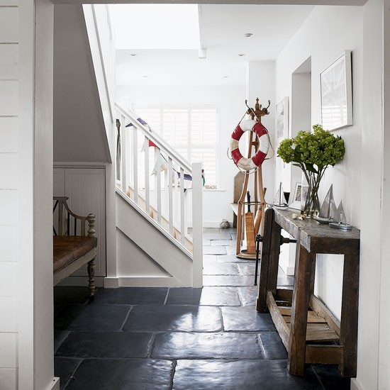 Country hallway with lifebuoy feature | West Sussex country house | House tour | PHOTO GALLERY | Country Homes and Interiors | Housetohome.co.uk