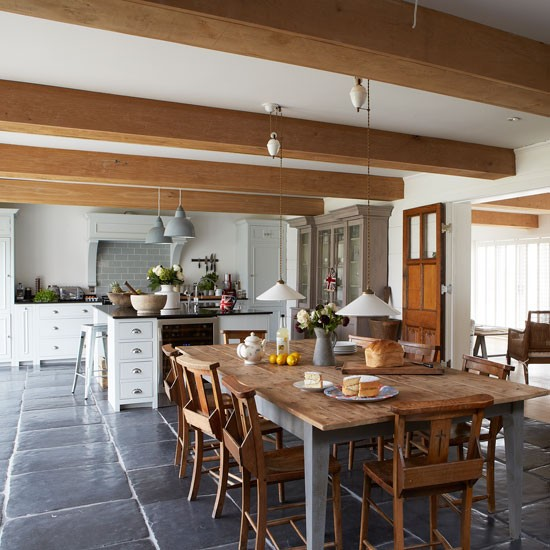 Farmhouse style kitchen diner with large wooden dining Define contemporary country