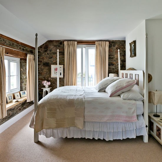 country bedroom with white four poster bed devon modern country