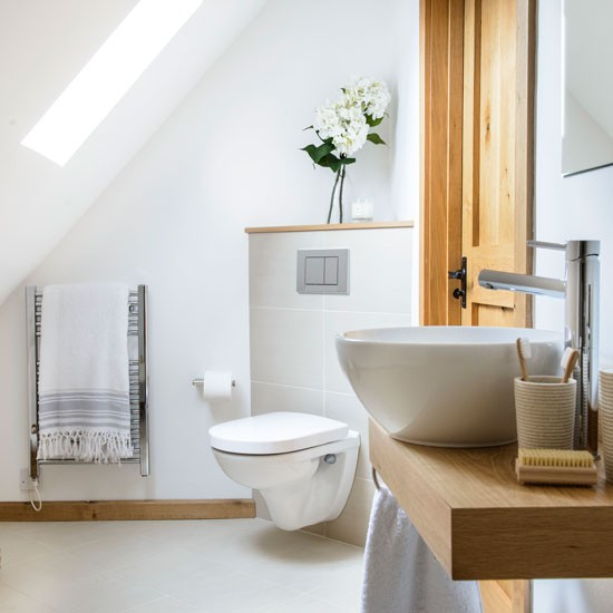 a space saving bathroom with corner cistern bathroom