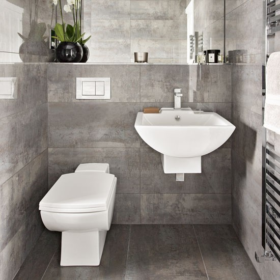 A grey bathroom with a floating suite bathroom suites for Bathroom suite ideas