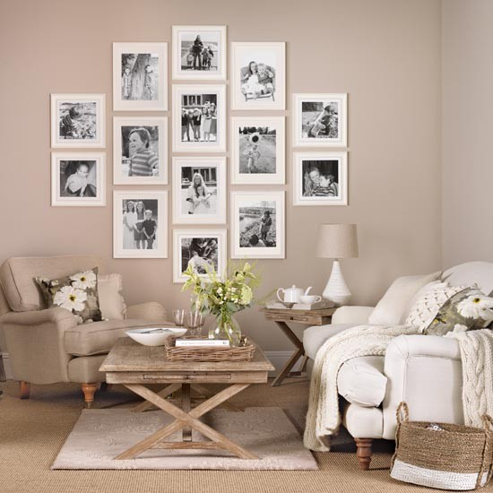 Neutral living room with family picture gallery simple for Simple family room ideas