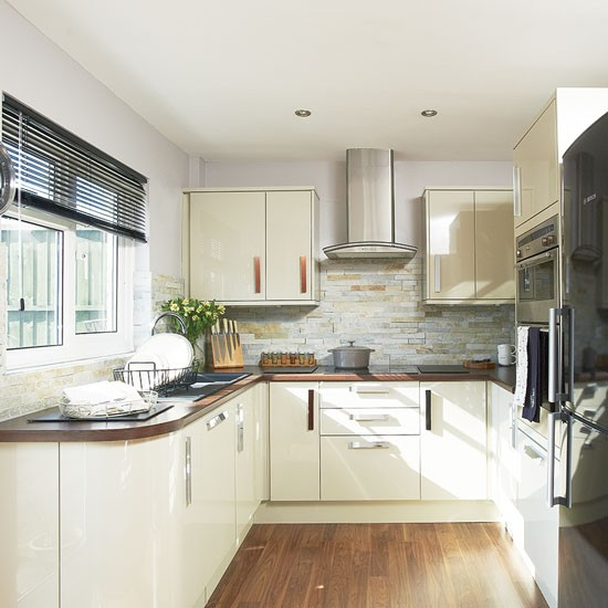 Cream gloss kitchen  Where and why laminate flooring can work for you