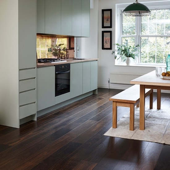 Junckers dark wood floor with pale green kitchen wood for Wood floors in kitchen