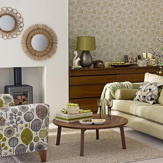 Green living room with patterned armchair mix and match living room