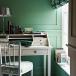 Green home office with elegant white bureau