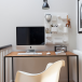 Hallway home office with sculptural wall storage