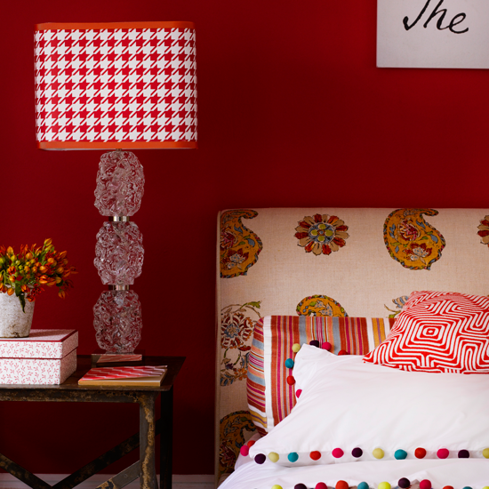 bedroom lighting scheme with red houndstooth table lamp