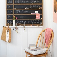 White home office with chalkboard noticeboard