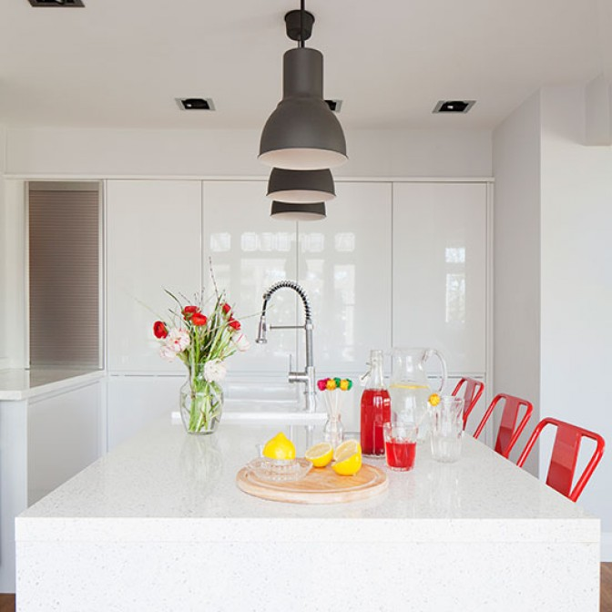 White modern kitchen with handleless cabinetry