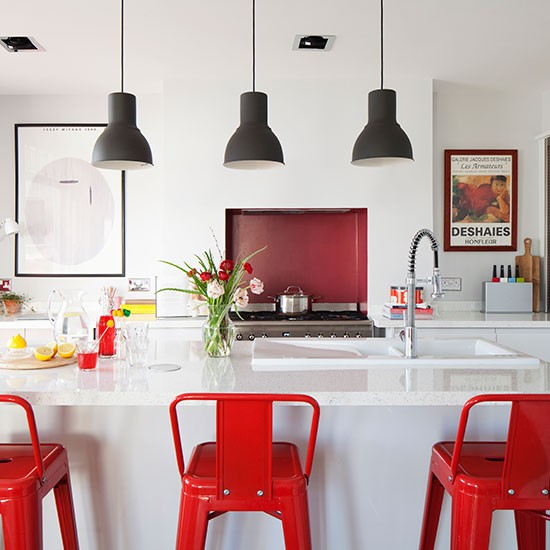 White modern kitchen with red chairs  Kitchen decorating  Ideal Home