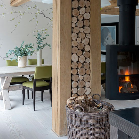 kitchen diner with log pile wall decorate with natural textures. Black Bedroom Furniture Sets. Home Design Ideas